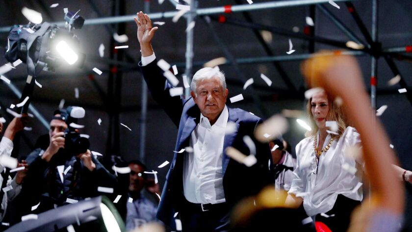 Andres Manual Lopez Obrador celebrates his election as the next Mexican president with supporters at the Mexico City's Zocalo, or central plaza, on Sunday.