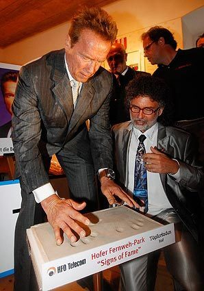 California's ex-governor, Arnold Schwarzenegger, provides his handprints during the inauguration of the Schwarzenegger Museum in his childhood home in Thal, near Graz, Austria. Many artifacts from the life of the former Mr Universe, Hollywood actor and politician are on display.