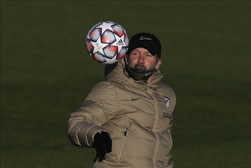 Atletico Madrid's coach Diego Simeone plays with the ball during a training session in Majadahonda, outskirts of Madrid, Spain, Monday, Oct. 26, 2020. Atletico Madrid will play its Champions League soccer match against RB Salzburg on Tuesday. (AP Photo/Manu Fernandez)