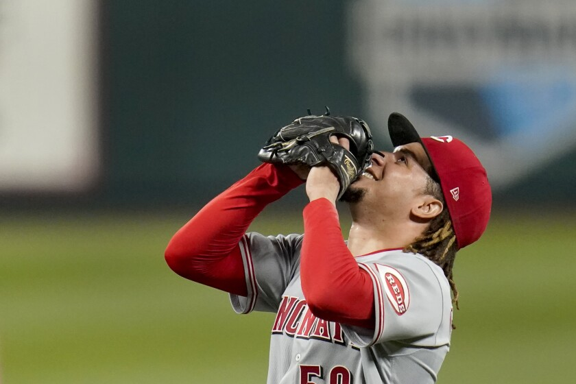 Cincinnati Reds starting pitcher Luis Castillo celebrates after throwing a complete baseball game against the St. Louis Cardinals Friday, Sept. 11, 2020, in St. Louis. The Reds won 3-1. (AP Photo/Jeff Roberson)