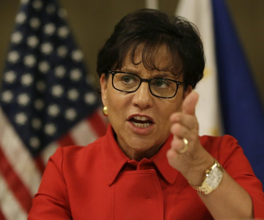 """U.S. Secretary of Commerce Penny Pritzker gestures during an audience with a select group of journalists following her address to the American Chamber of Commerce and Filipino businessmen Wednesday, June 4, 2014 at the financial district of Makati city east of Manila, Philippines. Pritzker told American and Filipino business groups Wednesday that the United States has overinvested its diplomatic, economic and strategic resources in other parts of the world. She said it was committed to policies """"to correct the imbalance and to deepen U.S. engagement"""" with Asia. (AP Photo/Bullit Marquez)"""
