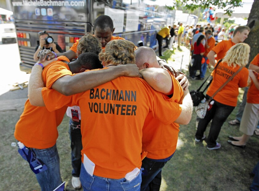 Campaign workers for Rep. Michele Bachmann huddle at the GOP's 2011 Ames straw poll, which she won. Five months later, after finishing sixth in Iowa's caucuses, Bachmann exited the presidential race.