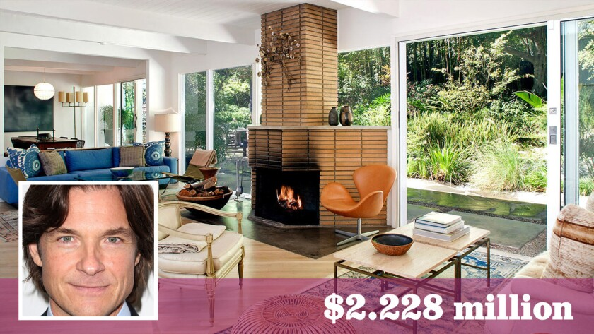 Walls and doors of glass and a stone fireplace are among the features of the 1953 residence sold by Jason Bateman.