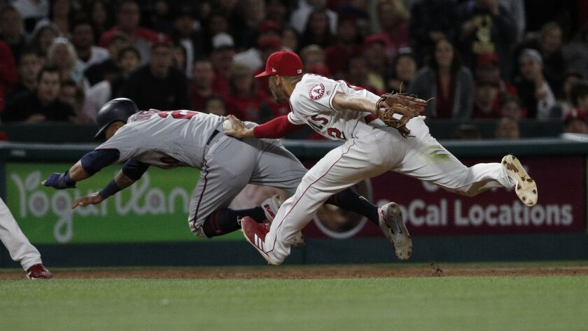 ANAHEIM, CA - MAY 12, 2018: Los Angeles Angels shortstop Andrelton Simmons (2) tags out Minnesota T