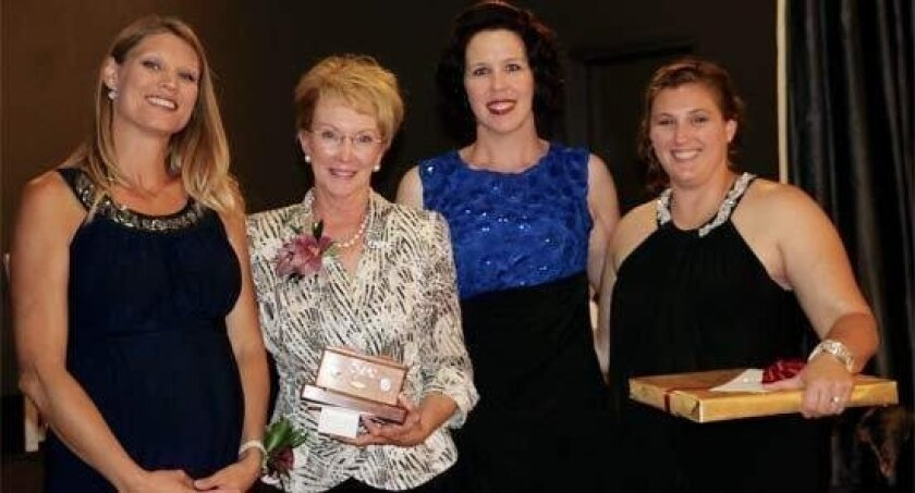 From left to right: Rachael Wunderlich, 2011 recipient of the Irene Ferguson Marine Wife of the Year Recognition Award, Bonnie Amos, former First Lady of the Marine Corps, Cyndi Stamps, 2014 recipient and Kimberly Reed, 2015 recipient.