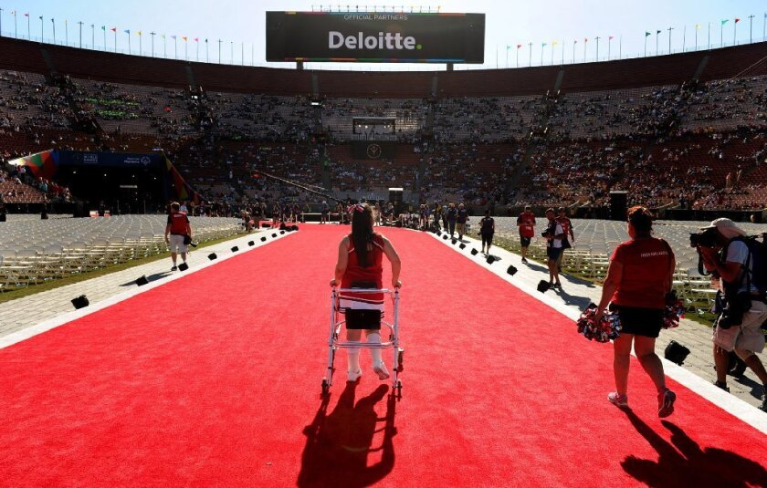 A cheerleader walks off the red carpet after a performance before Saturday's opening ceremony of the Special Olympics World Games at the Los Angeles Memorial Coliseum. (Wally Skalij/Los Angeles Times)