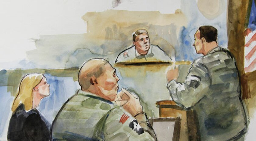 In this courtroom sketch, U.S. Army Staff Sgt. Robert Bales, second from left, sits next to Emma Scanlan, left, one of his civilian attorneys.