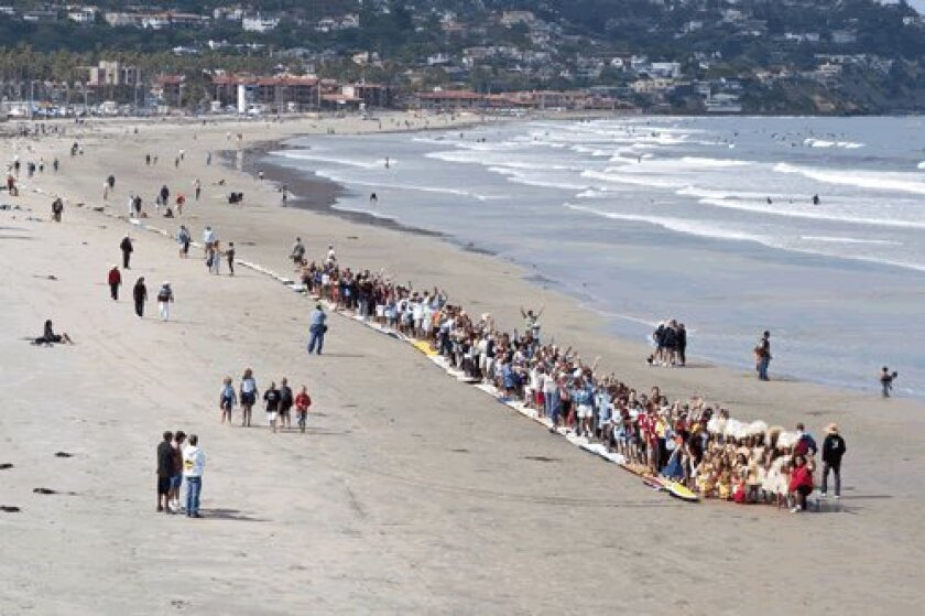 surfboards line up in the sand as a part of survivor Beach last year in la Jolla. This year, stand Up Paddleboard and paddle surfboards will line up in solidarity. courtesy