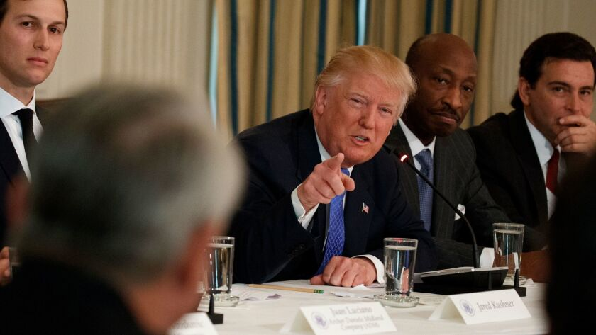 President Trump meets with manufacturing executives at the White House. From left are White House Senior Advisor Jared Kushner, Trump, Merck CEO Kenneth Frazier and Ford CEO Mark Fields.