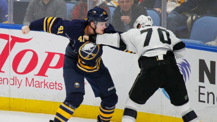 Sabres defenseman Justin Falk and Kings forward Tanner Pearson drop the gloves during a Dec. 13 game at KeyBank Center in Buffalo.