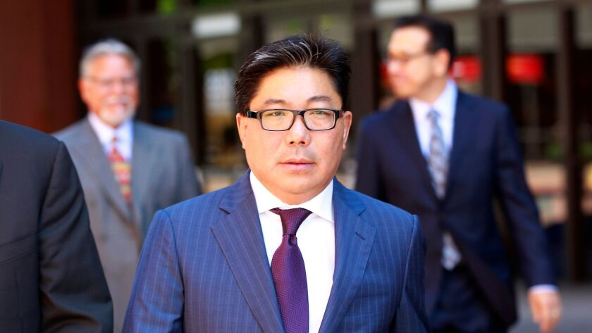 Wealthy Mexican businessman José Susumo Azano walks out of federal court in downtown San Diego after an August 2014 hearing. (K.C. Alfred / San Diego Union-Tribune)