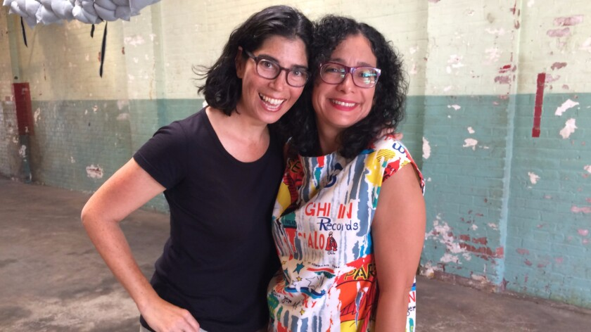 Artist Kim Schoenstadt, left, who organized the shoot, with painter Carolyn Castaño.
