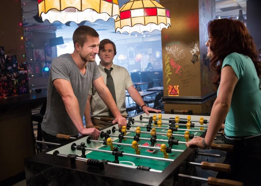 "Glen Powell, left, Haley Joel Osment and Castille Landon in the movie ""Sex Ed."""