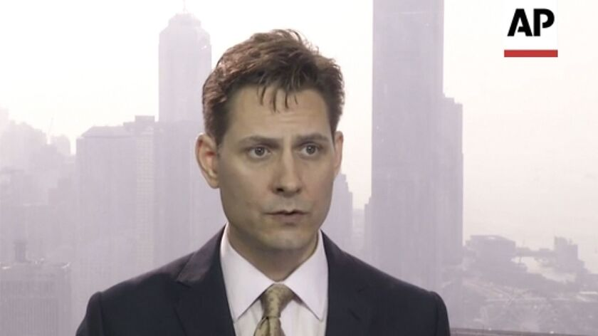 Former Canadian diplomat Michael Kovrig, shown in March, was taken into custody Monday night during one of his regular visits to Beijing.