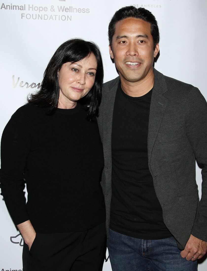 Animal activist Marc Ching at an event with actress Shannen Doherty in 2019.