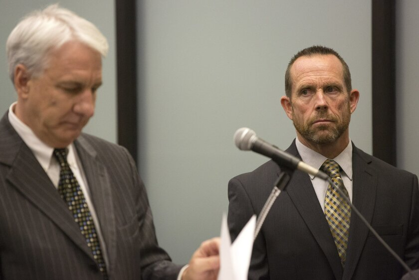 Kevin Brennick (right) at his arraignment.