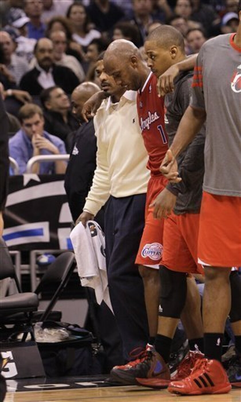 Los Angeles Clippers' Chauncey Billups (1) is helped off the court after he was injured during the second half of an NBA basketball game against the Orlando Magic, Monday, Feb. 6, 2012, in Orlando, Fla. The Clippers won 107-102 in overtime.(AP Photo/John Raoux)