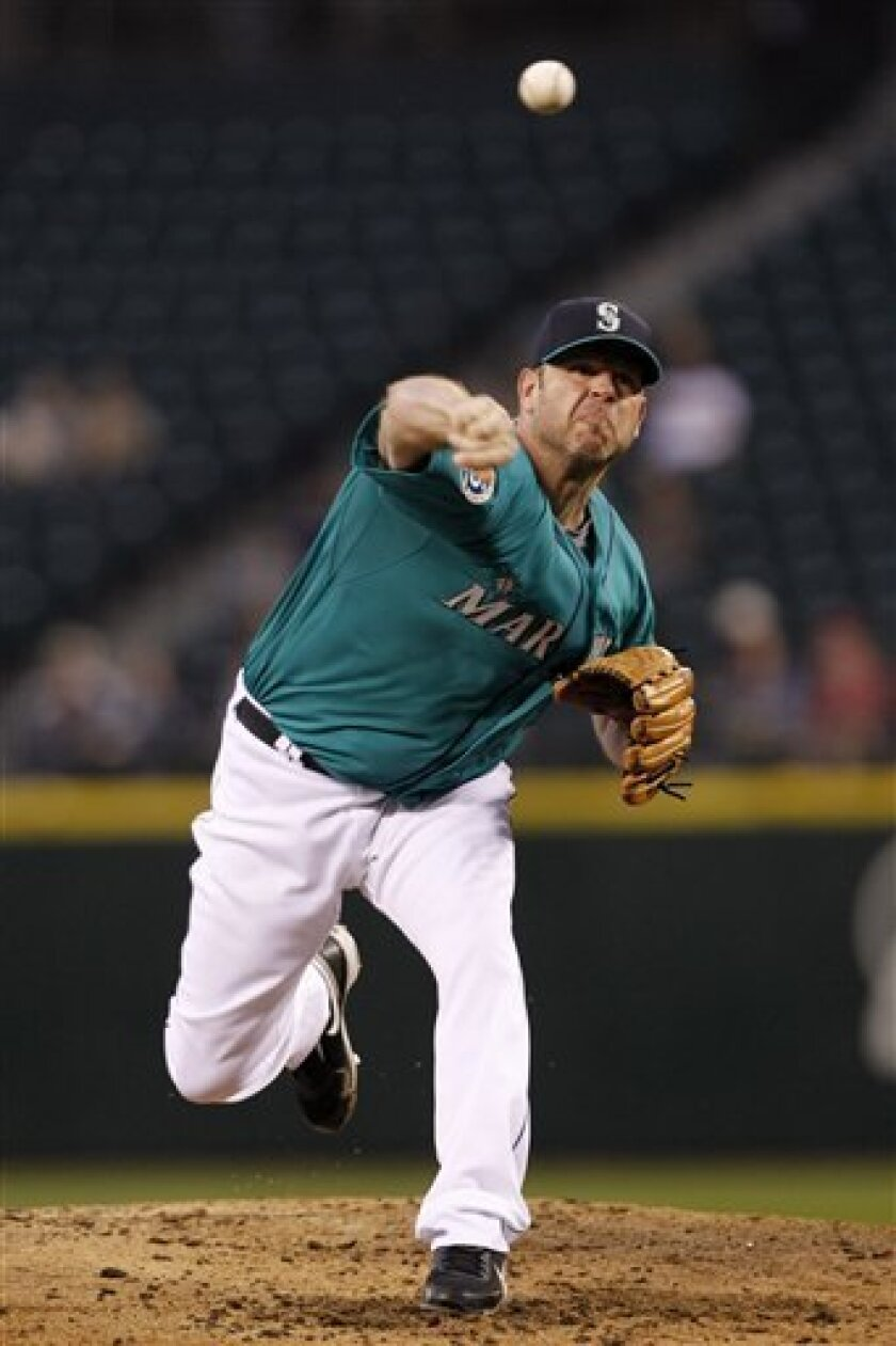 Seattle Mariners starting pitcher Kevin Millwood throws against the Los Angeles Angels in a baseball game Friday, Aug. 31, 2012, in Seattle. (AP Photo/Elaine Thompson)