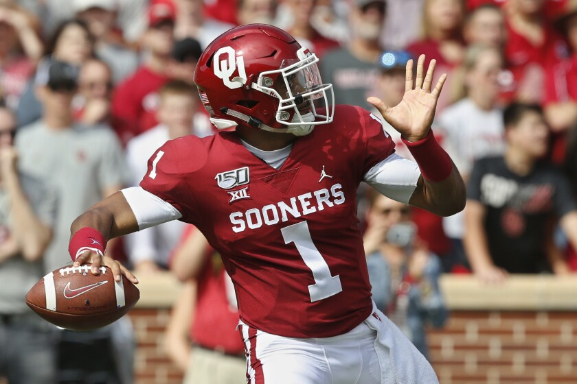 Oklahoma quarterback Jalen Hurts unleashes a pass against Texas Tech on Saturday.