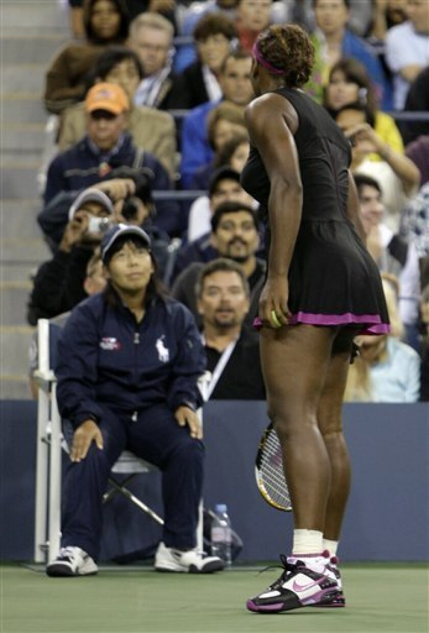 FILE - In this Saturday, Sept. 12, 2009 file photo Serena Williams, of the United States, argues with a line judge over a foot fault call during her match against Kim Clijsters, of Belgium, at the U.S. Open tennis tournament in New York.  Grand Slam administrator Bill Babcock tells The Associated P