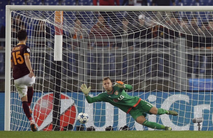 Roma's Miralem Pjanic  scores on a penalty kick past Leverkusen goalkeeper Bernd Leno his side's third goal, during a Champions League group E soccer match at the Olympic stadium, in Rome, Italy, Wednesday, Nov. 4, 2015. (AP Photo/Andrew Medichini)
