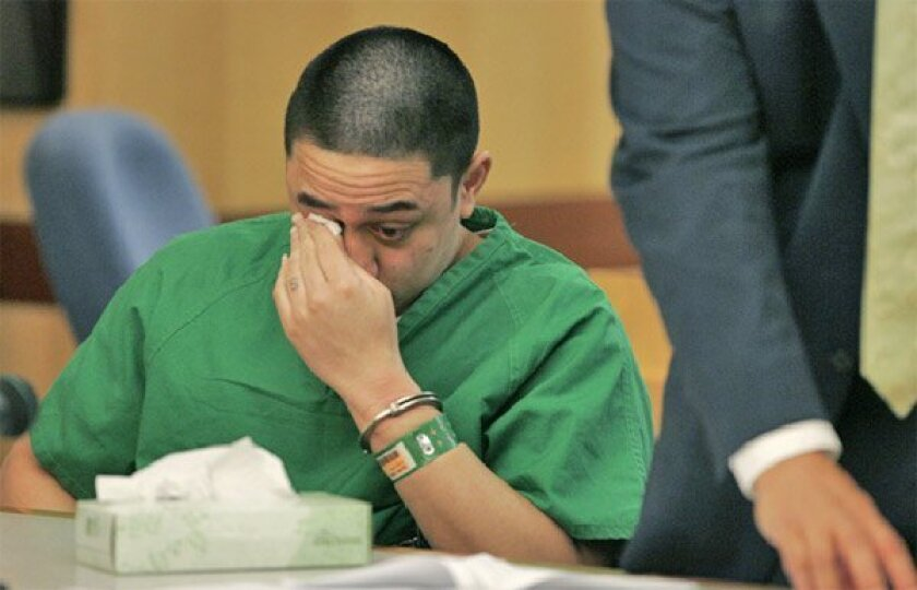 Meki Gaono wept before he was sentenced to life in prison  without the chance for parole in the 2006 murder of Oceanside  police Officer Dan Bessant. (Charlie Neuman / Union-Tribune)
