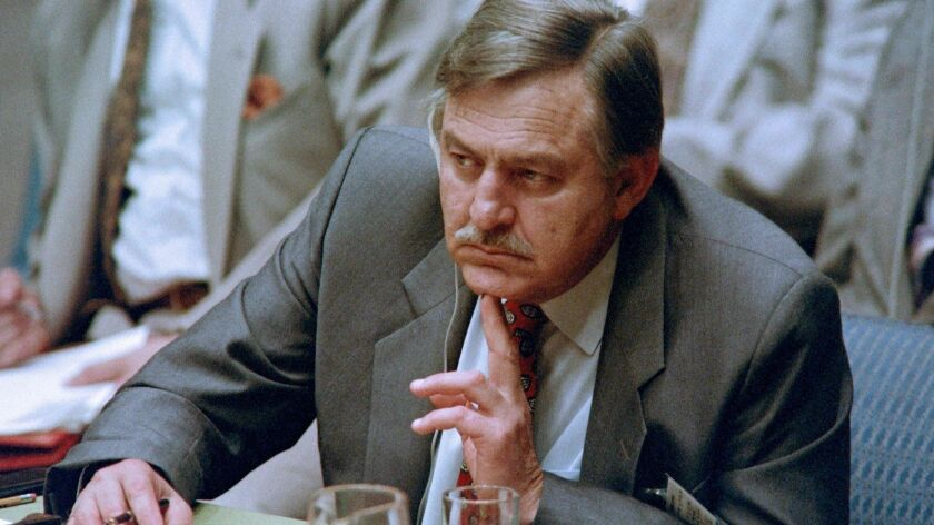 """Roelof """"Pik"""" Botha listens to a speech by Nelson Mandela to the U.N. Security Council on July 15, 1992. Botha died Friday at the age of 86."""
