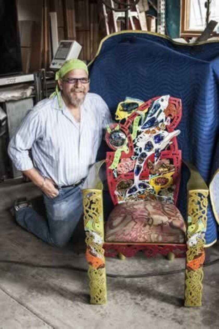 James stone, at his stone and Glass studio, with one of the chairs from his fish-centered series 'Last Call Before we eat them All. Lonnie Burstein Hewitt