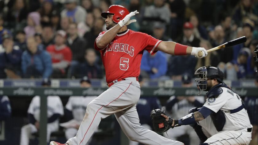 Los Angeles Angels Albert Pujols takes a swing during the eighth inning of a baseball game against t