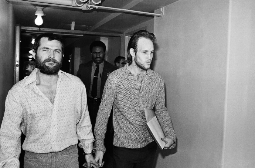 Bruce Davis, left, and Steve Grogan, leave court in 1970 after a court hearing. Gov. Jerry Brown denied Davis' parole Friday. It was the third time a California governor rejected the parole board's recommendation to release Davis.