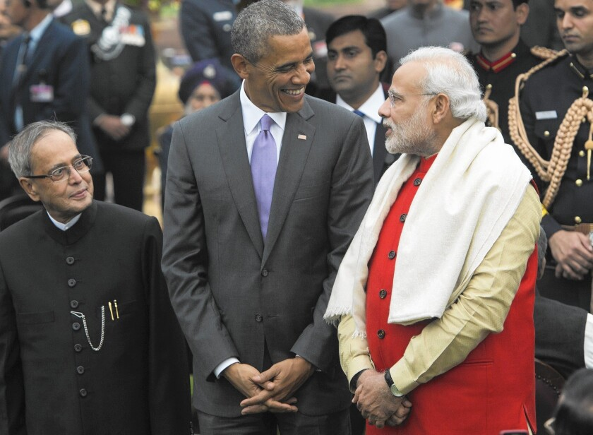 President Obama and Indian Prime Minister Narendra Modi, with Indian President Pranab Mukherjee at left, attend a reception at Rashtrapati Bhawan, the presidential residence in New Delhi.