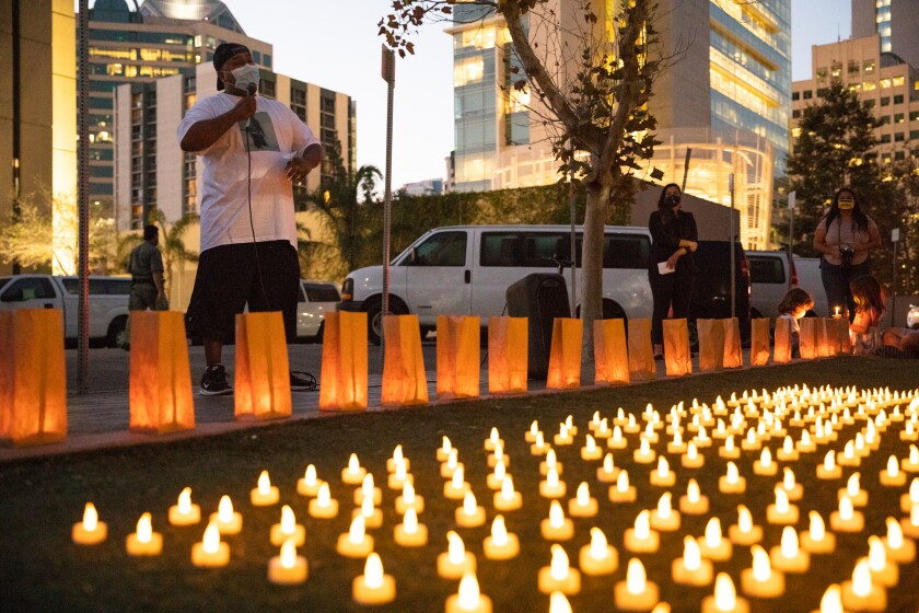 Rafael Cruz, cousin of Victor Ray Cruz, speaks at a Monday vigil in front of the Metropolitan Correctional Center San Diego.