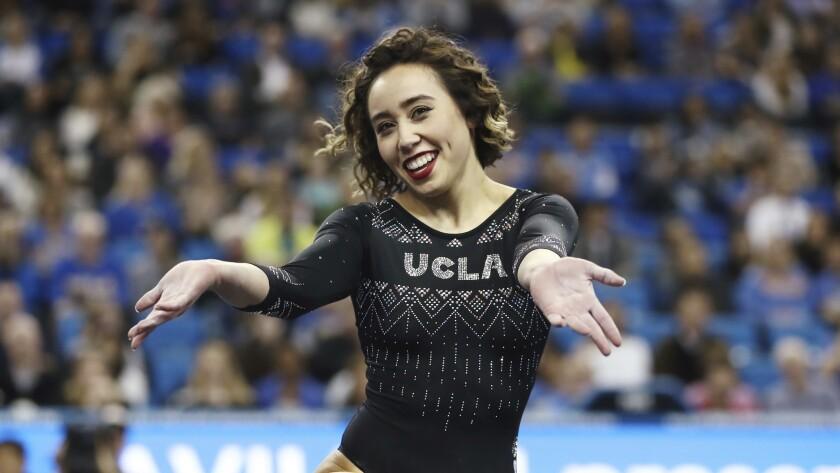 UCLA gymnast Katelyn Ohashi smiles during a meets on Jan. 4.