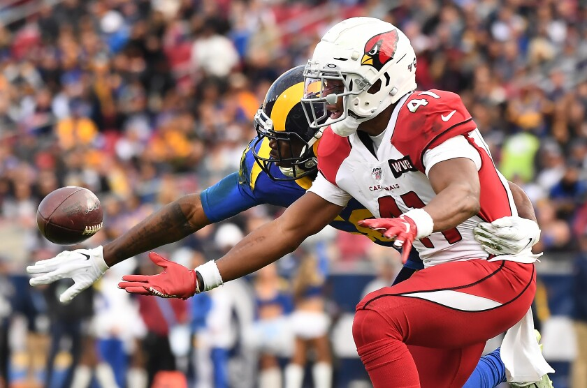 Rams linebacker Cory Littleton prevents Arizona Cardinals running back Kenyan Drake from making a catch.