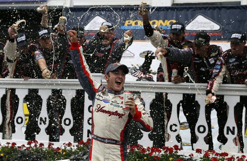 Austin Dillon celebrates in Victory Lane after winning the NASCAR Camping World Truck Series auto race at Pocono Raceway, Saturday, Aug. 2, 2014, in Long Pond, Pa. (AP Photo/Matt Slocum)