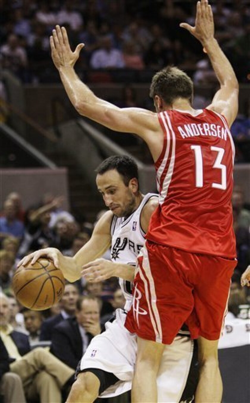 San Antonio Spurs' Manu Ginobili, of Argentina, left, is defended by Houston Rockets'' David Anderson, of Australia, during the second quarter of a preseason NBA basketball game in San Antonio, Tuesday, Oct. 6, 2009. (AP Photo/Eric Gay)