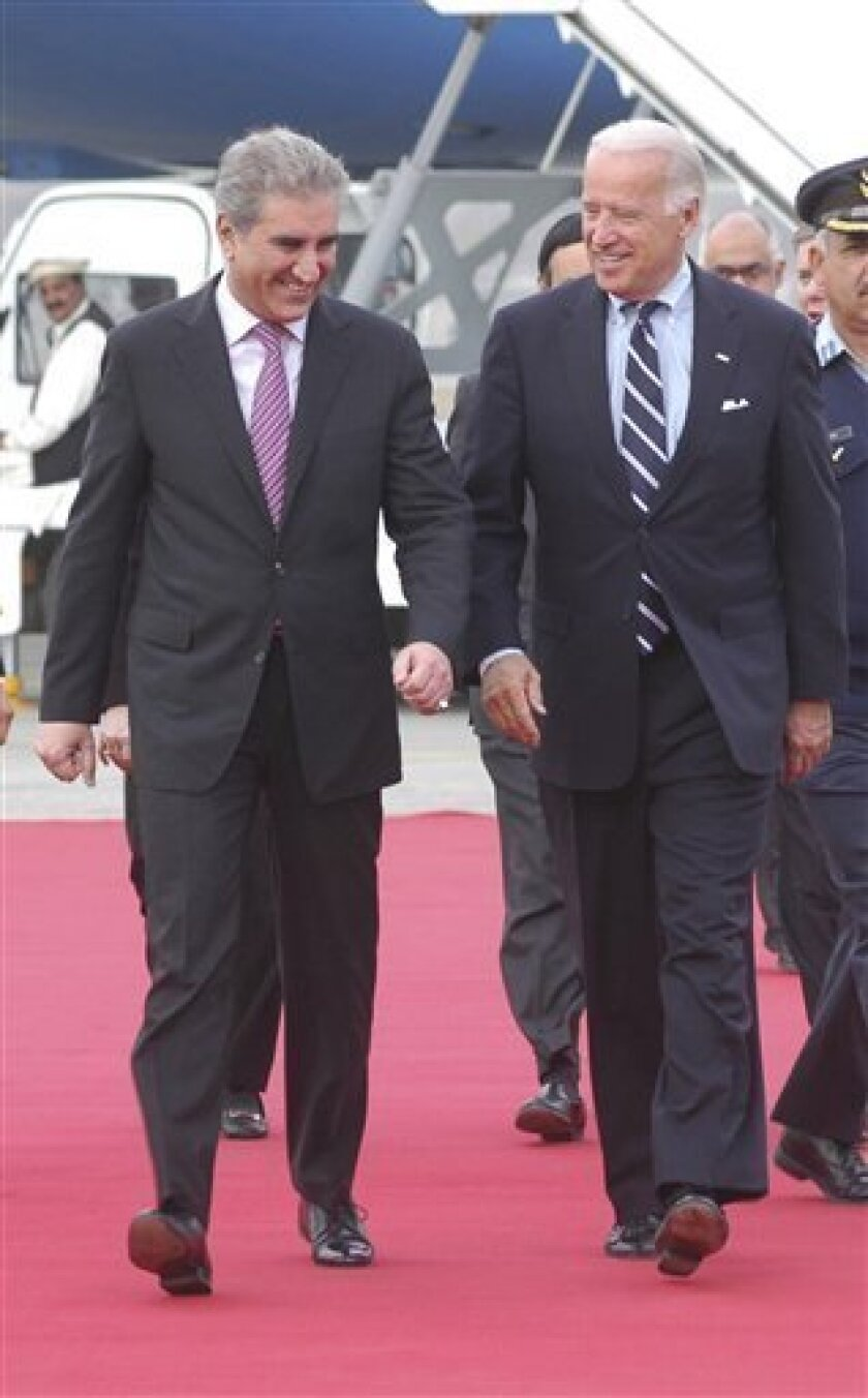 U. S. Vice President-elect Joe Biden, right, is received by Pakistan's Foreign Minister Shah Mehmood Qureshi upon his arrival at Chaklala airbase in Rawalpindi, Pakistan on Friday, Jan. 9, 2009. Biden, who is on a day visit to Pakistan met Pakistani leadership to discuss bilateral and regional secu