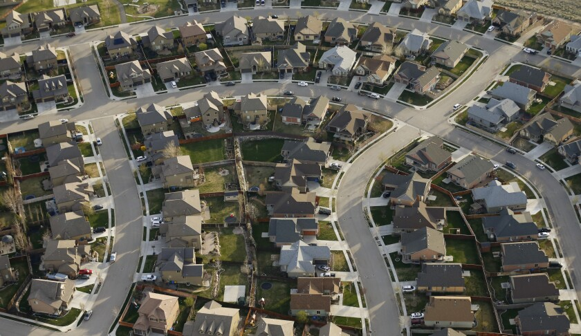 FILE - This April 13, 2019, file photo, shows homes in suburban Salt Lake City. Two studies released Wednesday, June 16, 2021, found that the nation's housing availability and affordability crisis is expected to worsen significantly following the pandemic, likely widening the housing gap between Black, Latino and white households, as well as putting homeownership out of the reach of lower class Americans. (AP Photo/Rick Bowmer, File)