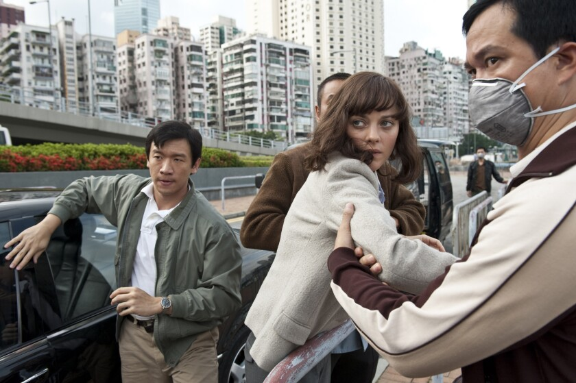 "In the film ""Contagion,"" starring Chin Han, left, and Marion Cotillard, a virus threatens to destroy humanity."