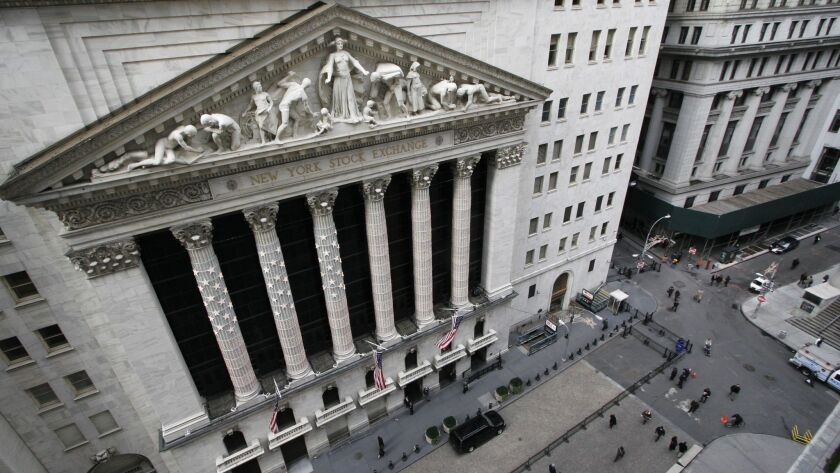 FILE - This Jan. 9, 2007 file photo shows the facade of the New York Stock Exchange. The powerful at