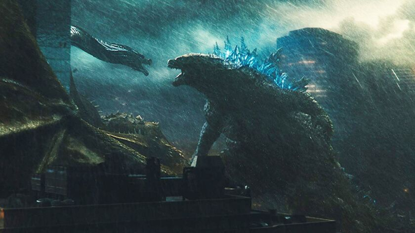 "King Ghidorah, left, and Godzilla battle in ""Godzilla: King of the Monsters."""