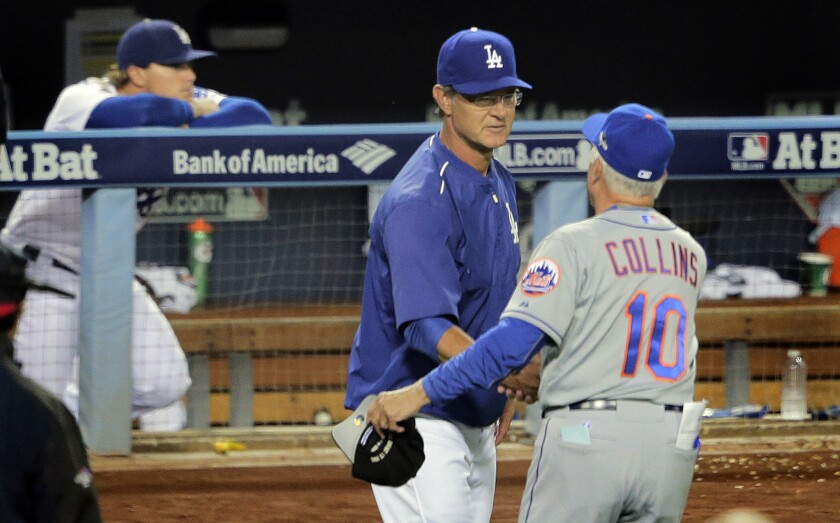 Manager Don Mattingly congratulates Mets Manager Terry Collins after the Dodgers were eliminated from the playoffs Thursday night.