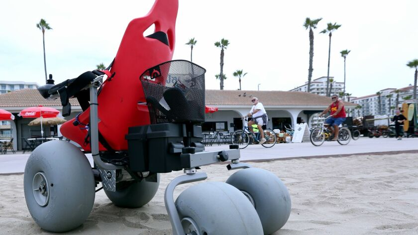 Bill Adamson, a retired Disney imagineer, invented this large-wheeled motorized wheelchair for his g
