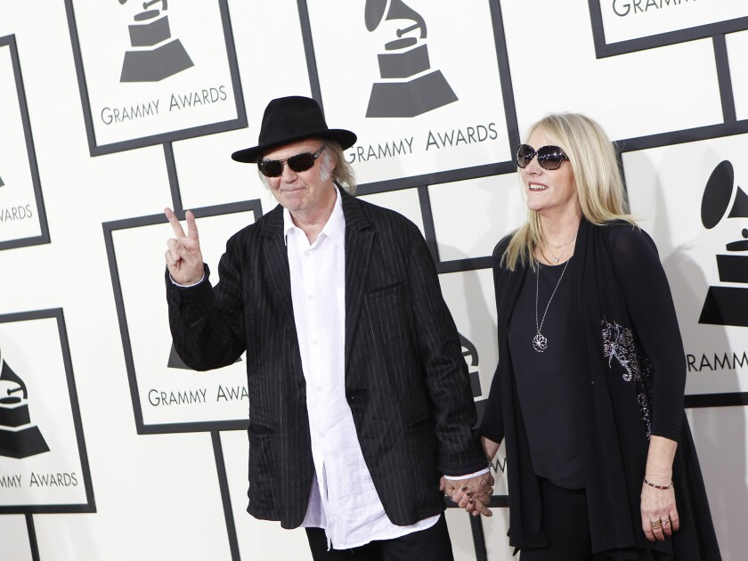 Neil Young and wife, Pegi, arrive for the 56th Annual Grammy Awards.
