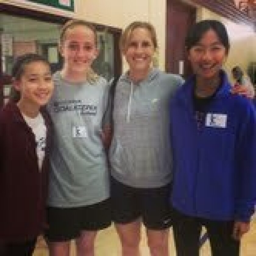 Ally Deremer (far left) and Linette Pan (far right) with Rachel Buehler, a soccer player on the USA Women's Olympic team (second from right) and their friend Katie (second from left). They met Rachel volunteering for the S4EA organization.