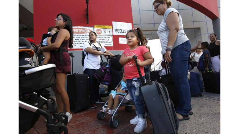 Cesar Ayala, second from left, and his family, including wife, Indira Viera, 38, right, daughters Sa