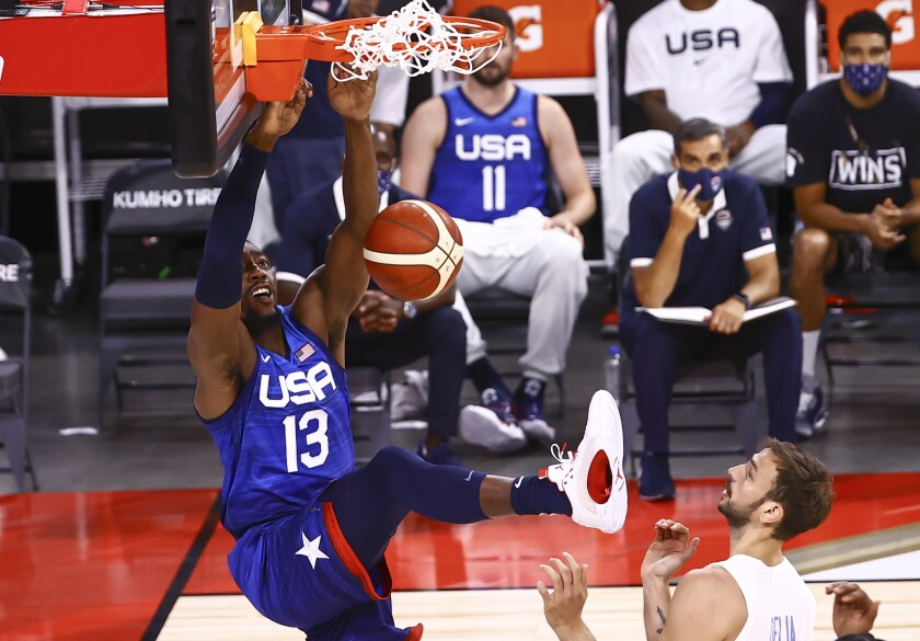 United States' Bam Adebayo (13) dunks the ball in front of Argentina's Marcos Delia during the first half of an exhibition basketball game in Las Vegas on Tuesday, July 13, 2021. (Chase Stevens/Las Vegas Review-Journal via AP)