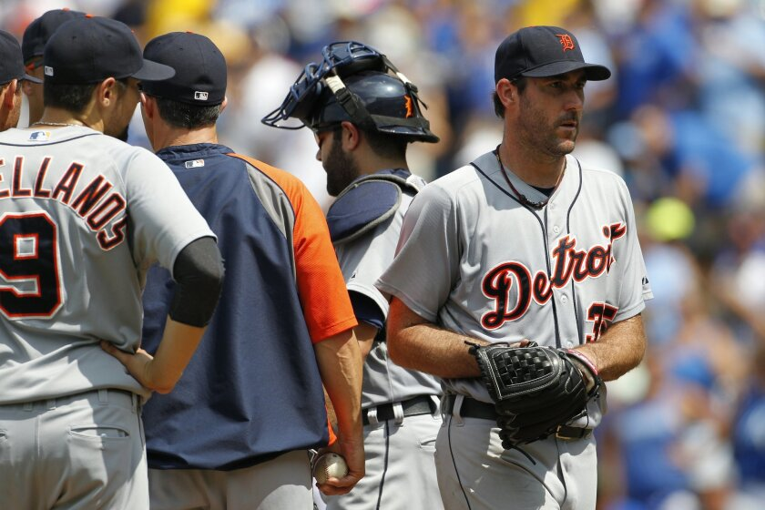 Detroit Tigers pitcher Justin Verlander leaves the mound after he was taken out of the baseball game against the Kansas CIty Roiyals in seventh inning at Kauffman Stadium in Kansas City, Mo., Sunday, July 13, 2014. (AP Photo/Colin E. Braley)