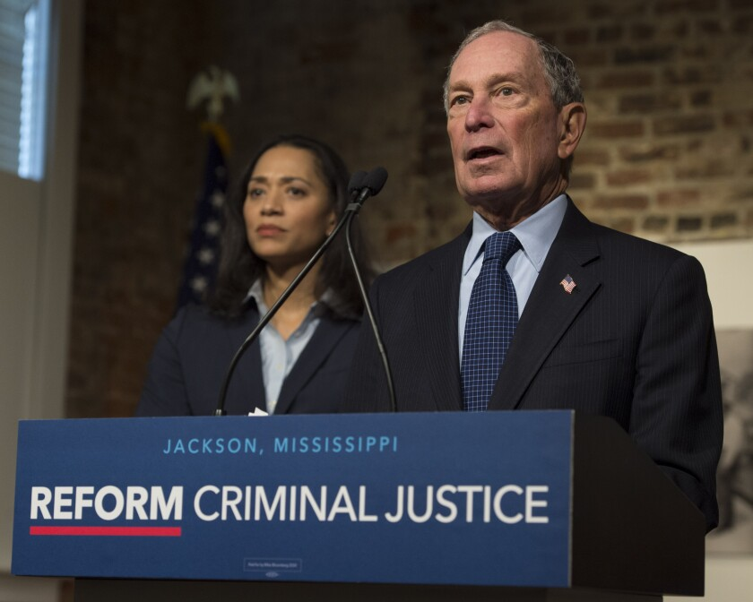 Democratic presidential candidate and former New York City Mayor Michael Bloomberg participates in a roundtable on criminal justice reform led by Jackson, Miss., Mayor Chokwe Antar Lumumba at Smith Robertson Museum, Tuesday, Dec. 2, 2019, in Jackson, Miss. Jennifer Jones Austin, CEO and Executive Director of the Federation of Protestant Welfare Agencies and NYC Department of Correction Board Member, listens at left. (Sarah Warnock/The Clarion-Ledger via AP)