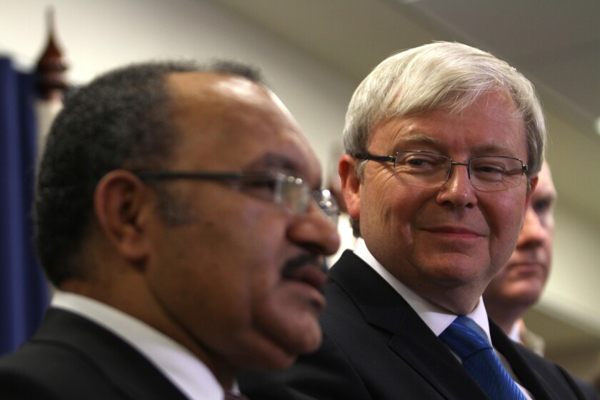 Papua New Guinea Prime Minister Peter O'Neill, left, and Australian Prime Minister Kevin Rudd announce a new policy on asylum-seekers at a news conference in Brisbane, Australia.